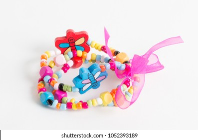 Bright bracelet with butterflies and bow for little girl on white