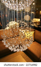 Bright brilliant chandelier at an exhibition of modern interiors