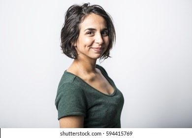 A bright brunette girl isolated on a white background