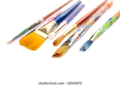 Bright brushes with paint on them