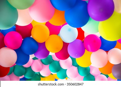 bright bunch of Colorful balloons. Background, low depth of focus.