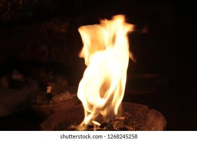Bright burning wood on a black background