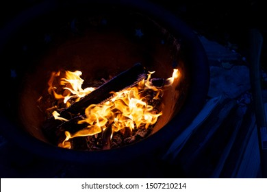 Bright Campfire Against Dark and Scary Background