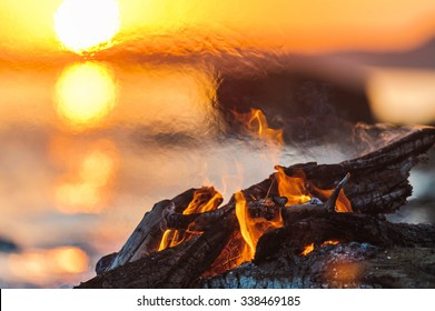 Bright campfire on the beach in evening
