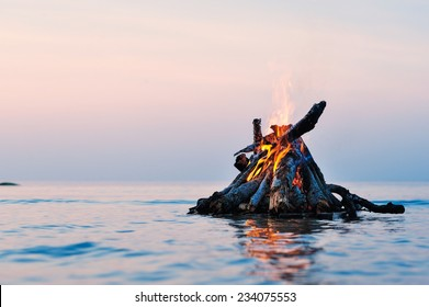 Bright campfire on the sea surface