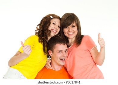 Bright Caucasian boy holding two girls in her arms on a white background
