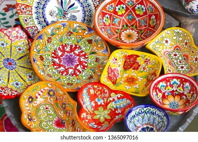 Bright ceramic bowls and plates, market store in bazaar, Middle East
