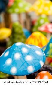 Bright ceramic mushrooms for decorating garden.