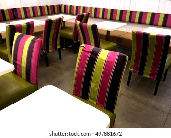 Bright chairs in the cafe