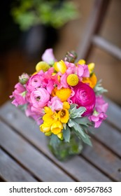 Bright and cheerful yellow and pink wedding flowers