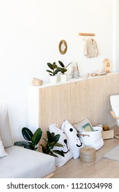 Bright children's room with houseplants and toys