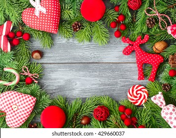 Bright Christmas background with branches of a Christmas tree and a Christmas decor.