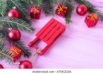 Bright christmas background with a fir-tree and toys