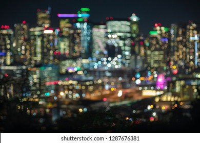 Bright City Skyline Lights Bokeh Background with Vibrant Colors