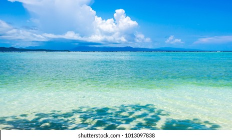 Bright clear sea water , sunny day and shadow, relax travel concept, Solomon islands