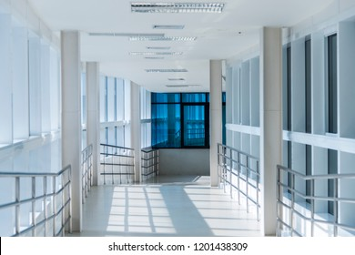 Bright clear tunnel with good lighting.Empty, tunnel like downhill ramp connection between two building.