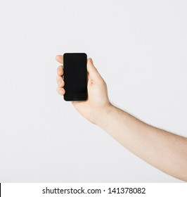bright close up of man showing smartphone