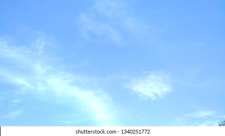Bright clouds with blue sky during the day as a background.