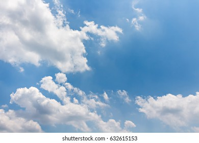 Bright clouds with day light and blue sky
