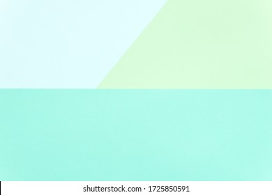 Bright color block paper background: turquoise, light blue and green. Copy space. Space for text. Flat lay, top view. Minimalist. Abstract