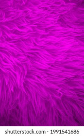 Bright color furry texture backdrop close up. Texture of wool skin. Abstract animal fur background. Hairy pattern for design. Fabric copy space colored background