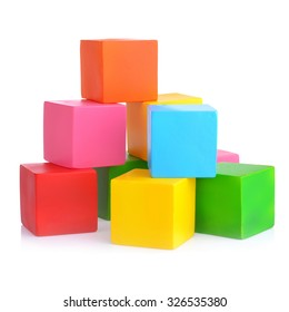 bright colored childrens cubes on a white isolated background