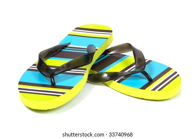 Bright colored flip-flops on a white background
