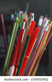 Bright colored glass sticks in a glassblowing workshop. Close-up background.
