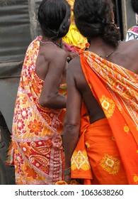 Bright colored sarees and bangles of tribal women in Kunduli, Orissa in India