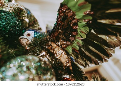 Bright colored toy parrot on the Christmas tree