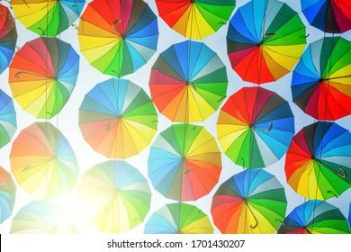 Bright colored umbrellas as a joyful background
