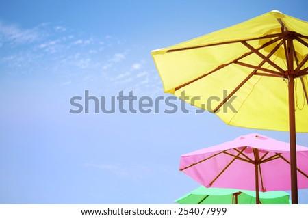 7b38de376 Bright Colored Umbrellas On Beach Stock Photo (Edit Now) 254077999 ...