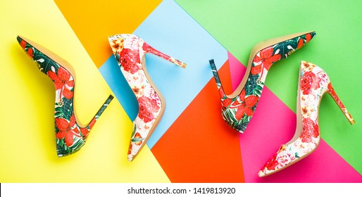 Bright colored women shoes. Beauty fashion concept, stiletto. Stylish female shoes in colors. Colorful leather shoes stiletto. Women shoe on color background. Stylish classic women leather shoe.