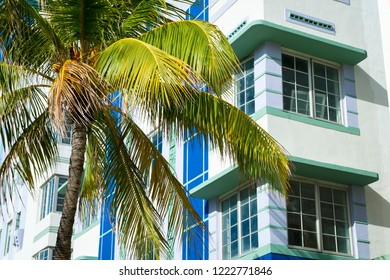 Bright and colorful detail view of classic Art Deco architecture in South Beach, Miami, Florida with tropical palm tree