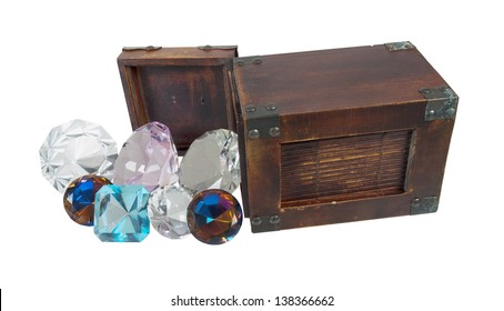 Bright and colorful gems pouring from a wooden box - path included