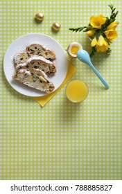 Bright Colorful Holiday Tables - Top View: Soft Boiled Egg, easter eggs, easter bread with Butter and orange juice Breakfast
