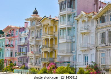 Bright colorful houses in Istanbul Bosphorus coastline. Arnavutkoy is popular, trendy and historical place near seaside.