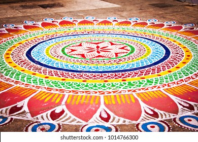 Bright and colorful Indian traditional rangoli decoration near Hindu temple in Chennai, South India