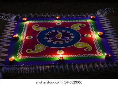 Bright and colorful Indian traditional rangoli decoration , Deepak with colourful rangoli