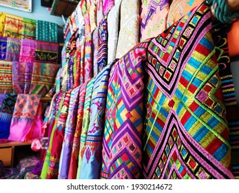 bright and colorful local textiles sale at the local market in Myanmar