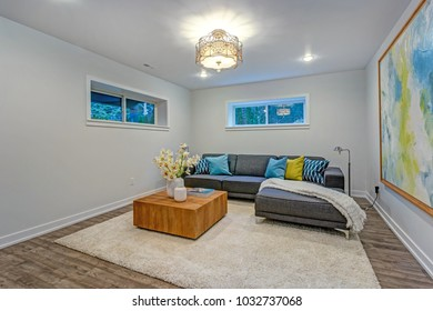 Bright Colorful Modern Family Room Interior With Wood Accents, Blue Pillows  On The Sofa And