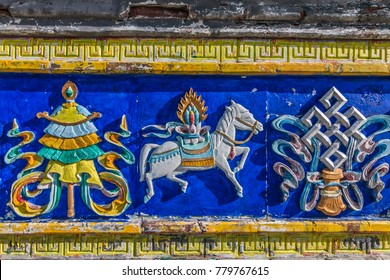 Bright colorful relief on the stupa, a symbol of Tibetan Buddhism