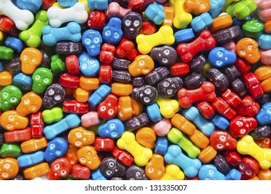 Bright and colorful skull and bone shaped candies in a gumball dispenser.