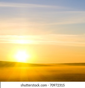 Bright colorful sunrise over the rural fresh summer morning meadow.Brightly-lit morning skies over summer landscape.Sunrise over a misty morning landscape.