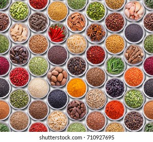 Bright colorful texture with spices and herbs over white background