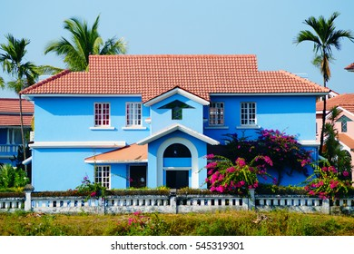 Bright colors. Blue house near the beach in Benaulim, South Goa, India. On the sunny day colors are more brighter.