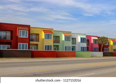 Bright colors of Red, Yellow, Green, Pink beach condominium vacation homes and buildings in Galveston Texas The modern architecture brighten the beachfront properties on the coast of Texas.