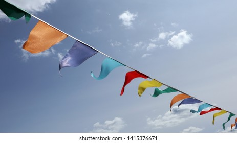 Bright colour flags dangle garland on wind