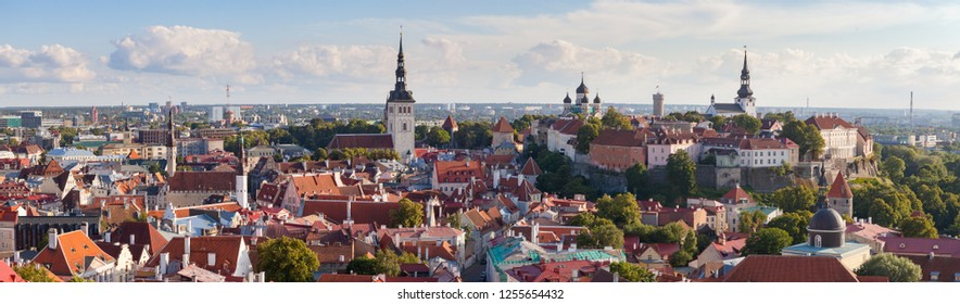 Bright colourful aerial shot of old town of Tallinn, Estonia at sunny day. A very vide panoramic.