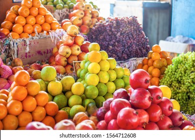 Bright colourful fruits: apples, oranges, grapes ,- on the indian street market